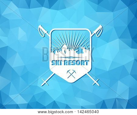 Vintage skiing resort or mountain patrol label, emblem or logo with mountain and ski poles on blue ice background