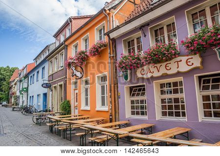MUNSTER, GERMANY - AUGUST 7, 2016: Colorful street with bars in Munster, Germany
