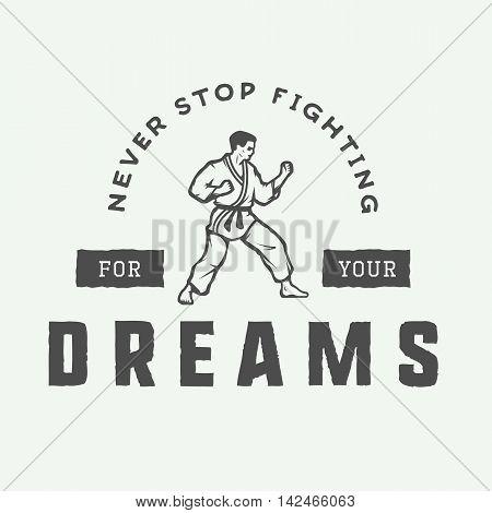 Vintage motivation logo emblem label poster or design print. Inspirational quote with karate fighter. Vector Illustration