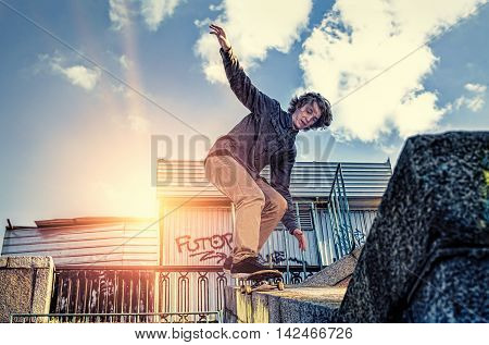 Young skateboarder doing a skateboard jumping trick in the city