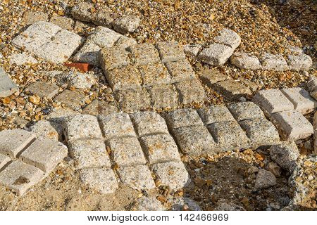 Like chocolate bars Beach Hardening Mats used in WWII used to allow tanks to move on pebble beach. Lepe Country Park Exbury Southampton Hampshire England United Kingdom