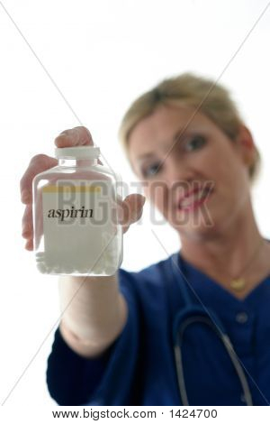Nurse Holding Bottle Of Aspirin