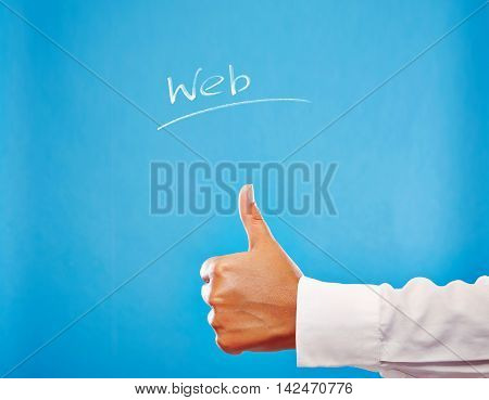 Business Hand showing thumb up on blue background