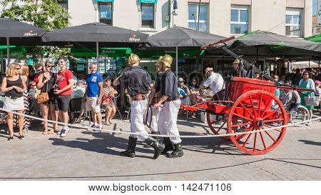 Antique Firefighters To Intervene With A Water Pump