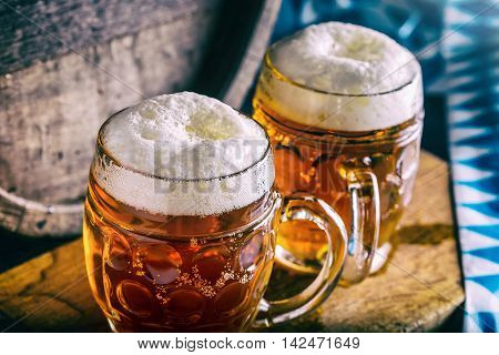 Beer. Oktoberfest.Two cold beers. Draft beer. Draft ale. Golden beer. Golden ale. Two gold beer with froth on top. Draft cold beer in glass jars in pub hotel or restaurant. Still life.