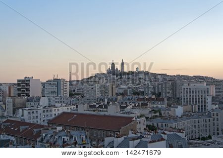 view in the evening of the Sacre Coeur in Montmartre Paris France