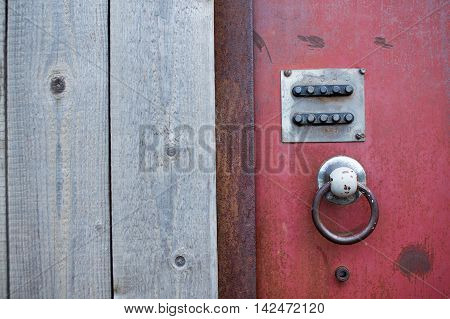 code lock on the iron door. combination lock on an old rusty iron door in a wooden fence. closeup. empty space for your text