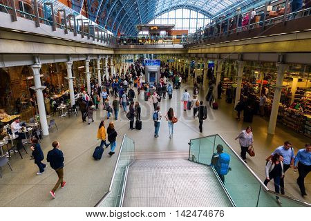 London UK - June 16 2016: Sankt Pancrass railway station with unidentified people. It is a central London railway terminus and Grade I listed building