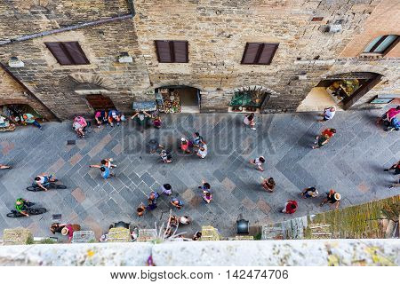 San Gimignano Italy - July 05 2016: town center of San Gimignano with unidentified people. The medieval town with its unique tower buildings is listed under the UNESCO World Heritage sites