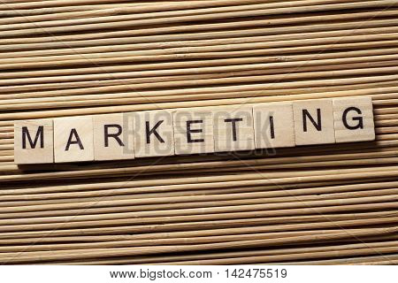Marketing word write wooden cube on table