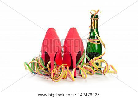 ladies red high heels stiletto shoes from the back champagne and streamers for a happy women's day party isolated with shadows on a white background selected focus