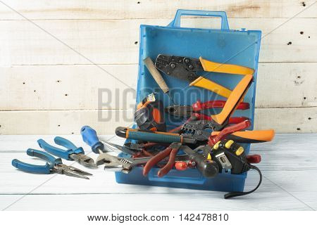 Construction tools on wooden background. Copy space for text. Set of assorted work tools. Top view.