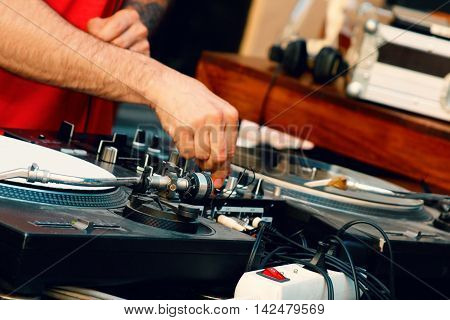 the DJ mix music at a music festival in the street