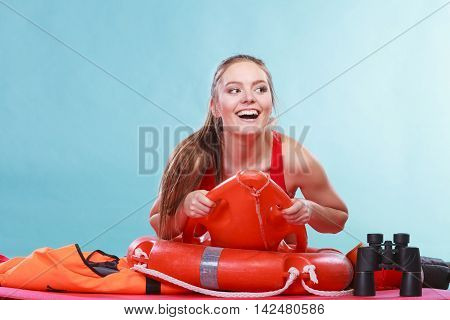 Happy Lifeguard Woman Lying On Rescue Ring Buoy.