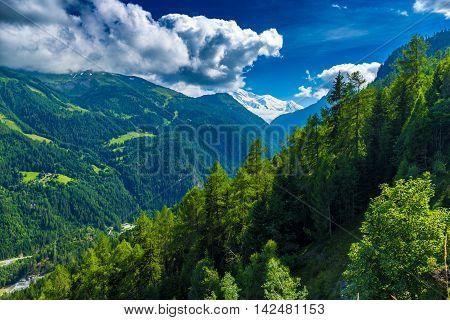 View Of The Valley Behind Emosson Dam And Mont-blanc Peak On Horizon Near Swiss Village Of Finhaut