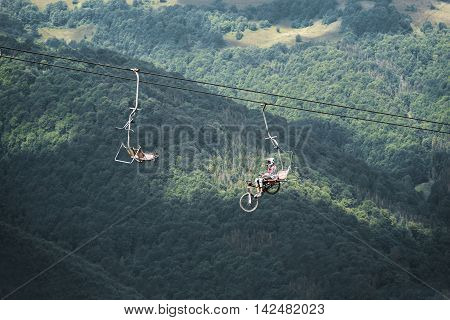 PILIPEC, UKRAINE - AUGUST 9: Bicyclist on the elevator lift in the mountains, on August 9, 2016 in Pilipec, Ukraine.