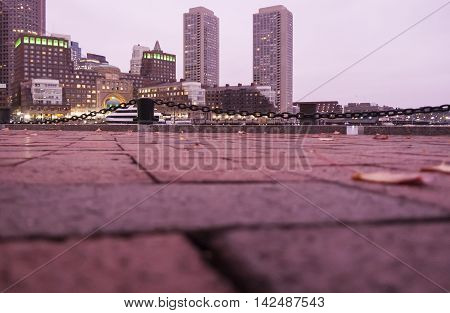 Ground level view of Rowes Wharf from Fan Pier in Boston