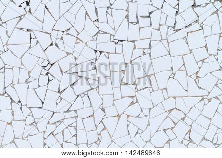 Big white broken tiles wall texture patern