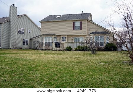 A small tract home in the Wesmere Country Club subdivision of Joliet, Illinois.