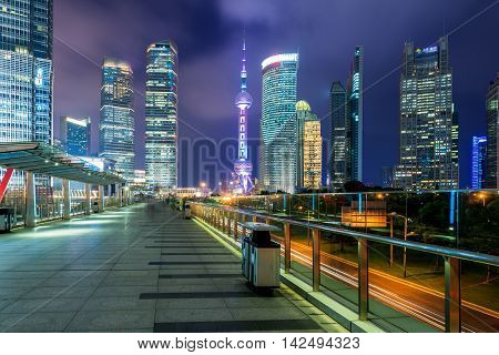 Shanghai Lujiazui skyscraper finance district and China Oriental pearl tower at night in Shanghai China.