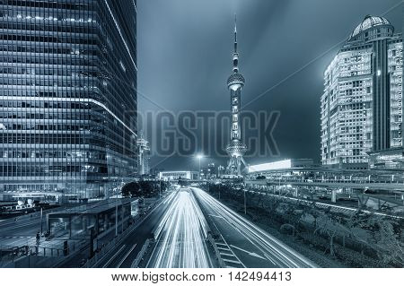 Shanghai city skyscraper and China Oriental pearl tower at night in ShanghaiChina. Blue tone city.