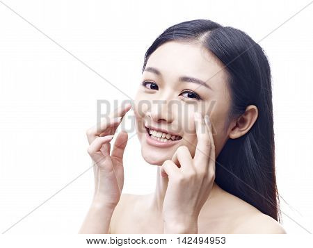 young and beautiful asian woman with clean fresh and smooth skin isolated on white background.