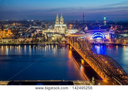 Cologne Germany. Image of Cologne with Cologne Cathedral during twilight blue hour in Germany.