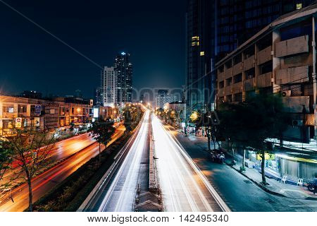 The Traffic Light Trails On The Street Of Bangkok