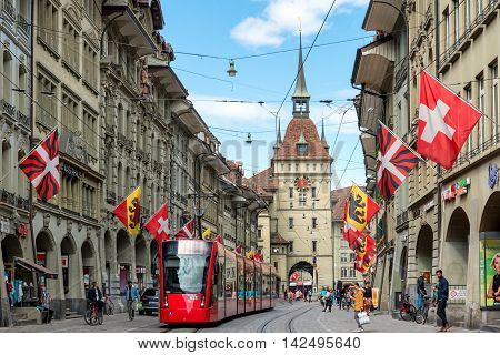 Bern Switzerland - May 10 2016 : Shopping street in the old medieval city of Bern Switzerland. In 1983 the historic old town in the centre of Bern Switzerland became a UNESCO World Heritage Site