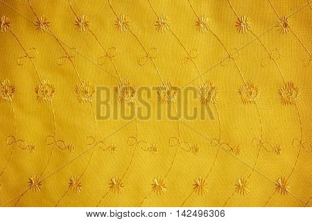 gold guipure embroidery on cloth for wedding dress texture