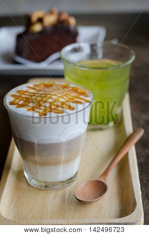 Close-up of a coffee macchiato on wooden plate