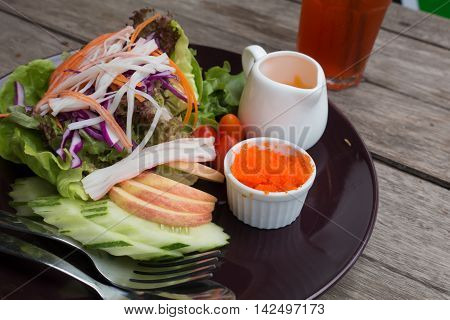 Salad of shrimps crab meat lettuce aquatic weed shrimp egg and tomato on dish