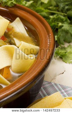 Oriental Lagman Uzbek soup on a wooden table