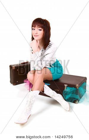 Young Girl With Old Suitcases