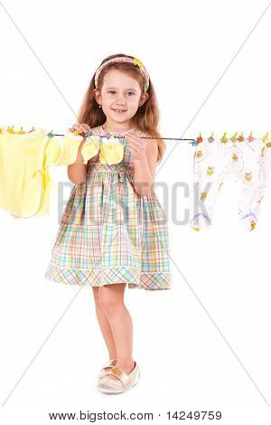 Cute Little Girl Drying Clothes