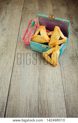 Haman ears cookies and grogger for Jewish festival of Purim
