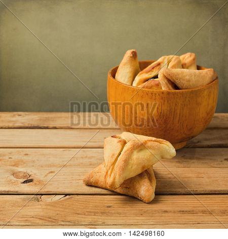 Traditional Hamantaschen cookies for Purim Jewish holiday in wooden bowl