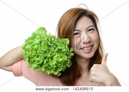 smile asian woman give thumb to hydroponics green oak vegetable isolated on white backgroundHealthy concept