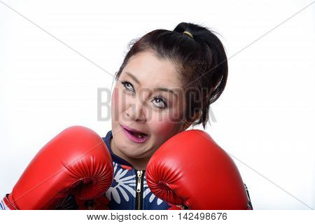 squint eyed crazy woman in boxing gloves isolated on white