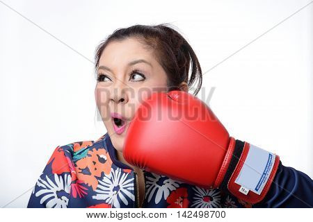 asian woman with red boxing glove punch her face on white background