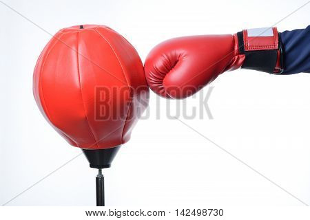 red boxing glove punch a red punching bag exercises isolated in white
