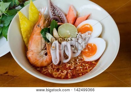 Thai style noodle tom yum kung on white bolw