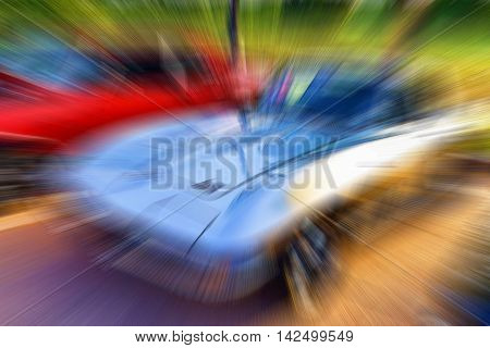 Blurred background of sports cars with room for your type.