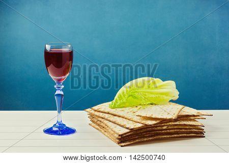 Jewish Passover holiday celebration background with wine and matzos
