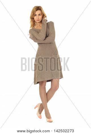 Fashion model wearing khaki sweater dress isolated