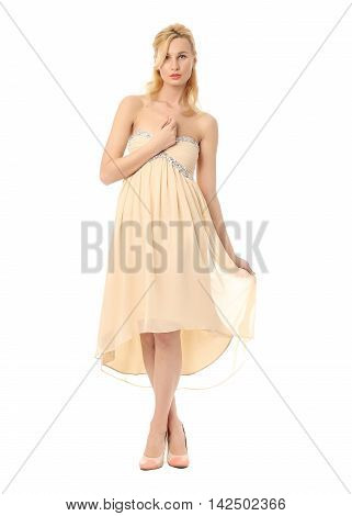 Fashion model wearing yellow prom dress isolated