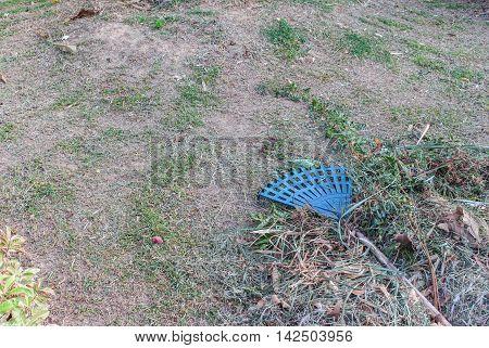Broom leave. Plastic broom in a garden Broom on a haystack .