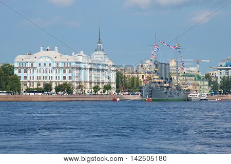 ST. PETERSBURG, RUSSIA - JULY 28, 2016: Nakhimov naval Academy and the cruiser