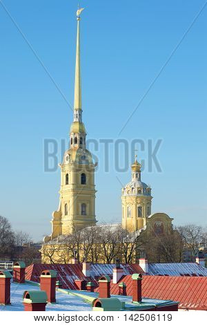 Spire of the Peter and Paul Cathedral above the roofs of the Peter and Paul fortress day in February. Saint Petersburg Russia