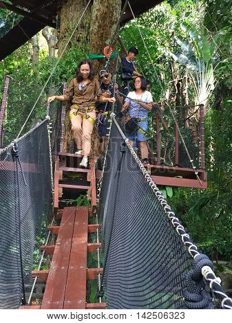 CHIANG RAI THAILAND - AUGUST 9 : vertical photo of unidentified people walking on canopy bridge on August 9 2016 in Chiang rai Thailand. This is a newest travel attraction in Chiang Rai.